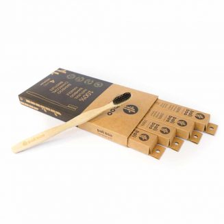 bamboo toothbrush on top of a box of 4 bamboo toothbrushes by Bali Boo